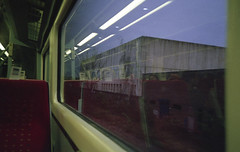 From a Train Window II (Mindori Photographic) Tags: film filmphotography filmisnotdead filmfeed filmforever buyfilmnotmegapixels buyfilmandmegapixels ishootfilm analoguephotography analogphotography analogue 35mm yashica yashicaminitec agfavistaplus200 train railway window trainwindow transport publictransport commuting morning motion concrete monolith