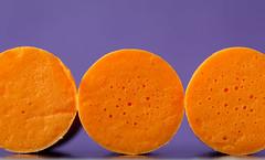 Macro Mondays - Three Theme (sephrocker) Tags: macromondays macro three orange purple foam circle earplug sponge