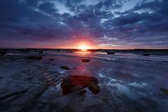 Sun flare    Long Reef (David Marriott - Sydney) Tags: collaroy newsouthwales australia au nsw long reef morning dawn sunrise flare focus sydney rock reflection cloud