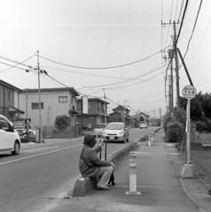 Waiting for the bus (odeleapple) Tags: yashica mat 124g yashinon 80mm kodaktmax100 film monochrome bw waiting bus road vehicle woman sidewalk