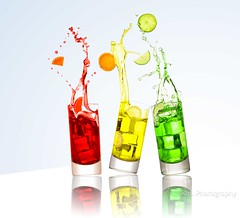 Happy Hour (Lily Garnier) Tags: splash splashes highspeedphotography liquid flash glasses isolatedbackground freezeframe colourful bright drink icecubes red yellow green fruit lemon lime orange canon 5diii copyrightlilygarnier