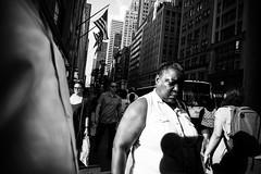 L1001271-2 (Anthony Tella) Tags: newyork newyorkcity nyc blackandwhite america usa women woman man flag money government shadows street streetphotography streets summer sky shadow signs fashion leica life leicam leicam240 m240 lens voigtlander voigtlander28mm 28mm 2017