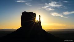 West Mitten Butte sunstar (NettyA) Tags: 2017 50mmlens arizona monumentvalley navajotribalpark sonya6000 themittens usa westmittenbutte clouds silhouette sky sunrise travel sunstar sunburst