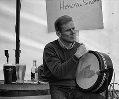 Playing the Bodhrán.... (Frank Fullard) Tags: frankfullard fullard bodhran music player musician candid street portrait festival monochrome swinford mayo irish ireland lol fun alcohol guinness tent