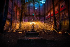 Fire in the Mill (Matt Straite Photography) Tags: steel wool spin spark light painting lightpainting color slow shutter yellow fire hot canon self graffiti abandoned mill venonia logging log industry old historical creepy timmer nature trees