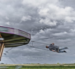 Happy (nokkie1) Tags: holland hongerigewolffestival carousel man clouds freedom movement landscape contrast