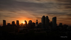 Calgary Sunset (Explore 27-07-17)! (Canon Queen Rocks (1,670,000 + views)) Tags: city cityscape buildings architecture structures sun sunset sky scenery scenic landscape panorama silhouettes sunburst clouds colours dusk canada calgary alberta views vista skyrises towers night momentsbyceline