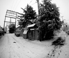 7th Ave and Scotia during Winter (MassiveKontent) Tags: vancouver bw urban blackandwhite monochrome city streetphotography britishcolumbia vancity vancouverisawesome veryvancouver vancouverbc pacificnorthwest gopro winter snow corner alley