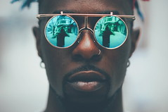 (Daifuku Sensei) Tags: jamelle stranger strangers candid portait male sunglasses shades dark goatee cool gold green toronto nikon85mmf18 nikond300 downtown queenwest bokeh nosering earrings piercing