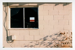 Room With A View (tobysx70) Tags: contax g1 rangefinder kodak royal gold 25 35mm 135 color negative film rz rollfilmweek july 2017 room with a view route 66 goffs california ca national trails highway hwy rt rte abandoned building wall broken glass window cinder block brick plant vegetation cable wire box shadow railroad railway freight train car gondola hyundai red square day3 toby hancock photography