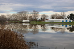 A peaceful morning on Clive River (Karen Pincott) Tags: clive river reflections water hawkesbay hawkes bay rowing clubwintertreescloudsnew zealand calm