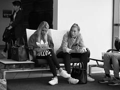 Airport people n. 1 (Franco & Lia (on/off)) Tags: street fotografiadistrada photographiederue danimarca denmark copenhagen københavn kastrup airport blackandwhite noiretblanc biancoenero girls mobile phone
