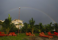 A rainbow in the sky (Ferdousi.) Tags: rainbow coxsbazar beachchairs red redbeachchairs bangladesh