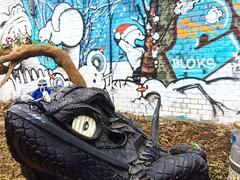 @TheRingOfDoom vs. Recycled Reptile (206liz) Tags: theringofdoom mfdoom clay sculpture recycledart mfdoomring ring makesomething nomadiccommunitygarden recycle tire tires rubber reptile lizard nomadicgarden shoreditch london england uk britain greatbritain nomadic garden art artgarden streetart calvin calvinandhobbes snowman bloks urban urbanart graffitiart travelgram travel travelphotography adventure misadventure ilovetravel justgoshoot snowballfight muralart murals mural photooftheday urbanhike nomad traveler intergalactictravel spreadlove shinelight intergalacticbridge spacetravel universalartcommunity figurine savetheplanet intergalactic