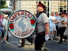 Banging his own drum (* RICHARD M (Over 6 million views)) Tags: street candid crowd imperialcorpsofdrumsliverpool orangelodge loyalorangelodge lol orangeorder loyalorangeinstitution orangemensday 12thjuly marchingbands bandmen basedrum bigdrum drummer uniforms peakcap peakedcap marchers marching marches bands musicians southport sefton merseyside sectarianism
