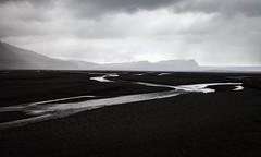 Barren (Jack Landau) Tags: lava fields river stream glacial water rock barren volcanic desert flow mountains clouds rain landscape nature iceland jack landau