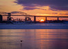 Industrial Canadian Sunset (Two Pine Trees Photography) Tags: sun internationalbridge sunset industrial bird freezing bridge canada cold saultstemarie snow clouds saultstemarieinternationalbridge