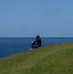Lost in Thought (metrogogo) Tags: lostinthought hillside grass green bluesea horison horizon thinking irishsea isleofman earthscurvature