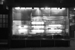 Clover Deli humid summer night (simply innocuous) Tags: summer humid rain night bw grayscale cloverdeli 2ndave 34thst manhattan nyc flag americanflag beer ale bottles cerveza