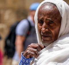 The Holy Land is so different from what I imagined, so strange… (ybiberman) Tags: israel jerusalem oldcity alquds christianquarter churchoftheholysepulchre deirelsultan easter pilgrim ethiopian woman old veil wrinkles nailpolish portrait candid streetphotography pain worry ie