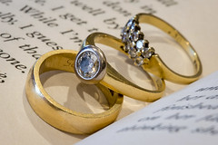 Three rings of marriage, the engagement ring, the wedding ring, and the suffering!!! (Taken-By-Me) Tags: gold rings metal book macro macromondays wedding diamond diamonds engagement band nikon takenbyme