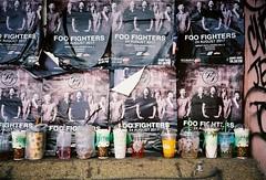 Foo Fighters (35mm) (jcbkk1956) Tags: posters flyers advertising signs music rock foofighters band performance street bangkok thailand thonglo film 35mm analog rangefinder vivitar vivitar35ee kodak ultramax400 uc400 worldtrekker rubbish cups graffiti