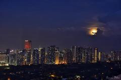 Moonrise at Blue Hour (Sumarie Slabber) Tags: moonrise moon bluehour city light skyline blue manila philippines sumarieslabber nikon sky lowlight longexposure beautiful clouds buildings tall dusk twilight