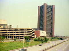 In the late 1950s and early 1960s, vast swaths of New Haven, Connecticut were demolished and replaced with sterile Brutalism architecture. The 1st National Bank, Temple Street Garage, Edward Malley's department store and Knights of Columbus HQ. July 1974 (wavz13) Tags: oldphotographs oldphotos 1970sphotographs 1970sphotos oldphotography 1970sphotography vintagesnapshots oldsnapshots oldhighways vintagehighways oldroads vintageroads vintagephotographs vintagephotos vintagephotography filmphotos filmphotography historicphotographs historicphotos historicphotography urbanphotography urbanphotos urbanscenes cityphotography cityphotos cityscenes vintagenewhaven oldnewhaven 1970snewhaven newhavenphotography newhavenphotos vintageparkinggarages oldparkinggarages 1970sparkinggarages carphotography carphotos automotivephotography automotivephotos connecticutphotographs connecticutphotos connecticutphotography oldconnecticutphotography oldconnecticutphotos oldconnecticut vintageconnecticut vintagenewengland oldnewengland 1970snewengland vintagenewenglandphotography oldnewenglandphotography newengland newenglandphotography newenglandphotos vintagenewenglandphotos oldnewenglandphotos elmcity 1970sconnecticut 110film kodacolor analogphotography instamatic pocketinstamatic vintagecars vintagecar oldcar oldcars 1960scars 1970scars collectiblecars collectablecars newhavenskyline vintagebuildings oldbuildings 1960sbuildings urbanarchitecture