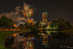 Fireworks including a helicopter flying through the scene (_patclancy56) Tags: yellow fireworks tulsa