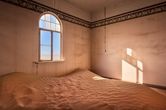 Abandoned House Full of Sand in the Ghost Town of Kolmanskop, Namibia (ansharphoto) Tags: africa abandoned african architecture barren blue building city climate color colour decayed demolition desert diamond door doorway drought dry dune empty environment german ghost green haunted historical history home house iconic interior kolmanskop kolmanskuppe landmark light luderitz namib namibia old orange red ruin sand shadow town travel urban view wall