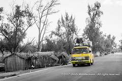 An overloaded yellow taxi brousse (Mazda Bongo) on the coastal road near Ifaty, Madagascar (Ulrich Münstermann) Tags: africa afrika city dorf farben ifaty madagascar mazda mazdaaccess mazdabongo mazdaeseries routenationale9 régiondeatsimoandrefana strase transportation automobile blackwhite car cargo coastalroad colours dorp duotone halftone kleuren overloaded road straat street taxi taxibrousse transport village voiture