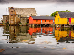 Fishing for colours (Geoff Eccles) Tags: ballstad fishingvillage leknes lofotenislands norway norwegian archipelago brightcolors colouredhouses fisherhouses reflecting reflection rorbur stillwater stilts