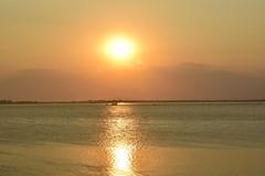 Sunset and rain (fdlscrmn) Tags: sunset rain river dam 7dwf reflection silhouettes clouds dawn