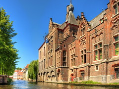 Along one of Bruges' canals (Digidoc2) Tags: water buildings worldheritagesite trees sky blue architecture oldcity town cityscape houses warehouses banks canal urban