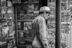 A tragic day in the city. México City Downtown. (Christian S. Mata) Tags: street contrast sony a6000 1650 méxico mexico man paper news bnw blackandwhite blancoynegro byn bn mono noir