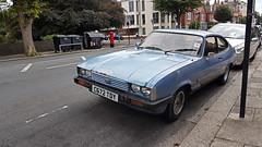 1986 Ford Capri 2.0 Laser. (ManOfYorkshire) Tags: c672tdy ford capri coupe laser 20 20ltr hatchback car auto automobile blue brighton sussex 2door original shoddy worn tape rust rusting