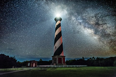 cape hatteras lighthouse and the milky way_ (Robert Loe) Tags: electricty power energy light illuminated lighthouse capehatteraslighthouse capehatteras beach island stars nightskystars lightpainting lightcrafter milkyway space nightscape grass northcarolina outerbanks obx summer glow clearsky sky atmosphere
