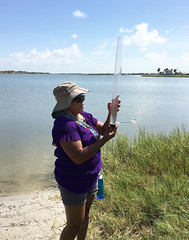 Kathrine Clark a middle school science teacher from Sabinal ISD uses a turbidity tube to measure water clarity in Little Bay, Rockport. Photo credit: Kristin Evans. (utmsimedia) Tags: tote nerr reserve teachertraining