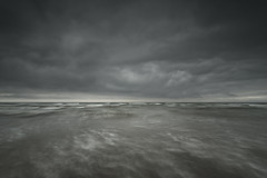 Brewing (Peter Henry Photography) Tags: water sea waves sky clouds weather grey movement beach shore coast minimalist