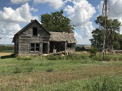 This Old House (pam's pics-) Tags: ks kansas us usa america midwest pamspics pammorris sky clouds iphone7s appleiphone mobilephonephotography rural cameraphone house countryroad abandoned oldhouse windmill barneskansas greenleafkansas farm homestead