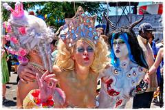 """Mermaids, Baphomets & Other Positive Characters..."" :-) (Alexxir) Tags: mermaid day parade girlstranslgbtrainbowinclusiveheadpiecewighornsblackwig baphomet'shorns eyeballs pasties mirrors colonialwig newyork lacegloves photographybrooklynstreetphotographpaulapagehothotlookinggirlfakesquirtingtitsredshorts tits breasts darkmakeup comicbookcharacter piercednavallickinglipstongueassspreadinglegsstandingsplit brooklyn photography streetphotography people summer"
