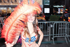 tips (spanaut) Tags: street newyork unitedstates us tipeconomy timessquare streethustler streetphotography woman feather babe candid