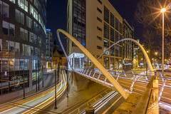 Flyby (Tim van Zundert) Tags: manchester greatermanchester urban picadillystation bridge manchestercurve curvebridge tram lighttrail northwestengland architecture city night evening longexposure sony a7r voigtlander 21mm ultron
