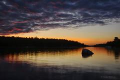 Always Different (Lindaw9) Tags: clouds sunset shanty bay westarmoflake nipissing rock treeline boathouses lake