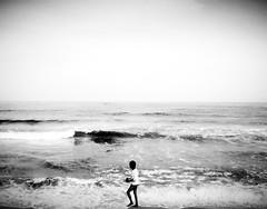 Marina Beach, Chennai (gokulkrish3) Tags: marinabeach boy playing sea chennai