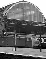 Kings Cross London 10th March 1975 (loose_grip_99) Tags: london kings cross station england uk railway railroad rail train blackwhite noiretblanc diesel engine locomotive ecml class47 brush type4 trainshed roof 1975