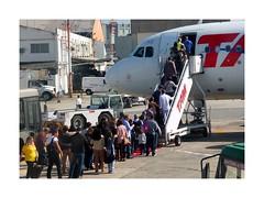 Boarding (in Explore July 15, 2017) (W Gaspar) Tags: sãopaulo airplane airport people boarding congonhas brazil brasil southamerica latinamerica x10 fujifilm finepix photoborder urban