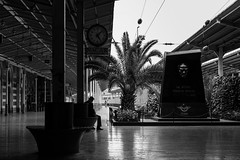 Tired and brooding / Der Radwechsel (*) (Özgür Gürgey) Tags: 2017 50mm bw brecht d750 darkcity nikon sirkeci architecture lines poem repetition street trainstation istanbul turkey