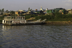 Mekong Ferry (Keith Kelly) Tags: asia bassacriver boat cambodia cocacola cruise kh kampuchea mekongferry mekongriver phnompenh seasia southeastasia tonlesap advertising aroundtown capital city docked ferry ride river riverbank sign signage sunset water