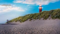 Cloudscape Panorama of the lighthouse of Texel NL (Bart Ros) Tags: ifttt 500px sunrise red beach island light clouds cloudscape coastline lighthouse tower horizon holland netherlands sand running sundown cloud panoramic dunes bay dune grassland runner beaches nederland texel wadden noordholland waddeneilanden grass